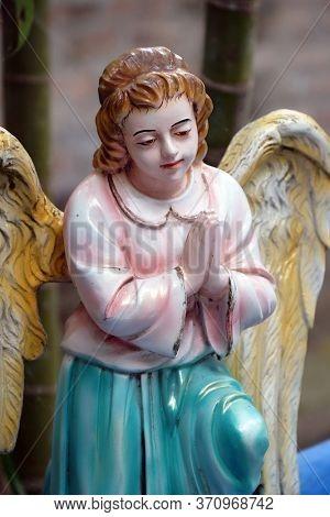 KUMROKHALI, INDIA - FEBRUARY 24, 2020: Angel at the Tomb of the Croatian Jesuit Missionary Ante Gabric Behind the Catholic Church in Kumrokhali, West Bengal, India