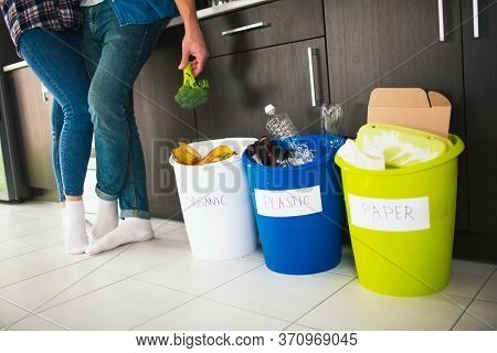 Close-up Concept. Sort Garbage At Home. There Are Three Buckets For Different Types Of Garbage. Youn