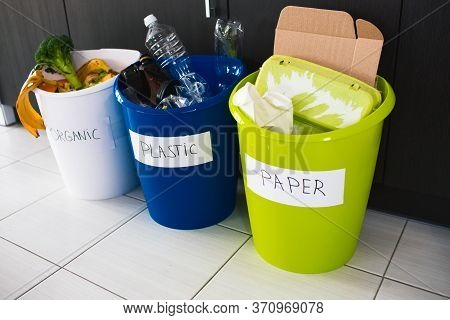 Close-up Concept. Sort Garbage At Home. There Are Three Buckets For Different Types Of Garbage. Sort