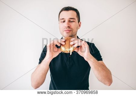 Young Man Isolated Over White Background. Guy Hold Tasty Delicious Burger In Hands And Ready To Eat