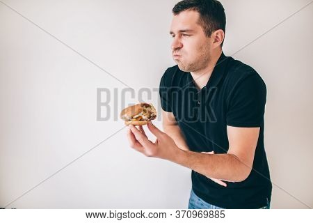 Young Man Isolated Over White Background. Sick Guy Suffer From Vomit Because Of Bad Unhealthy Unfres