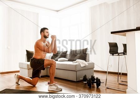 Young Ordinary Man Go In For Sport At Home. View Of Hardwoking T-shirtless Guy Sportsman Gets Up And