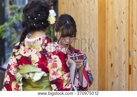 Kyoto, Japan - November, 8, 2019: Couple Of  Young Japanese Girls Wearing Traditional Geisha's Kimon