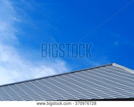 Slate Roof And Slope With Clouds And Blue Sky Background.tile Roof Of Construction House With Blue S