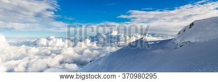Blue Sky Background With Tiny Clouds In Panoramic View. Mount Blanc.
