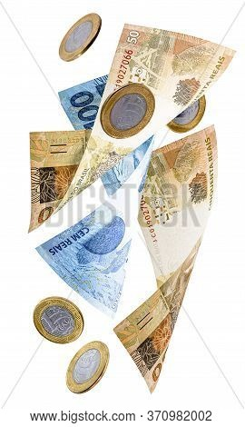 Money From Brazil Falling, Notes Of One Hundred Reais And Fifty Reais With Coins Of One Real, Fallin