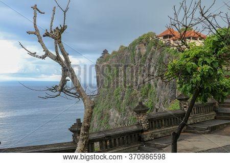 View Of Uluwatu Cliff With Pavilion And Blue Sea In Bali, Indonesia. Uluwatu Temple Pura Luhur Uluwa