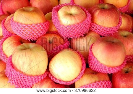 Fuji Apples Fruit With Red Foam Covering Selling In Public Market