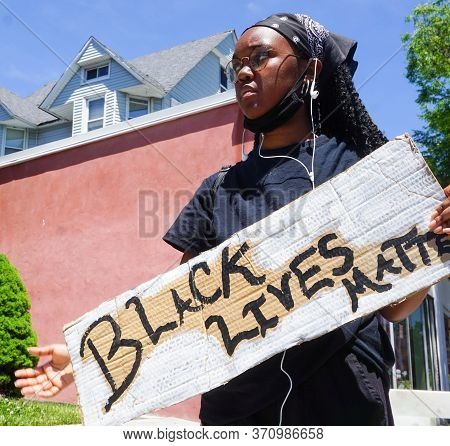 Young Female Holding Black Lives Matter Sign George Floyd Black Lives Matter Protest In The Streets