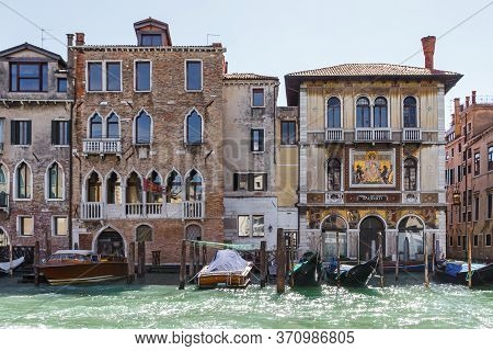 Venice, Italy, September 28, 2015 : Water Channels Of Venice City. Facades Of Residential Buildings