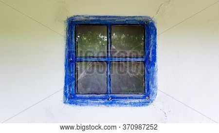 Old Window In A Vintage Traditional Peasant House In Ukraine. Antique Wooden Window Frame. Pirogovo
