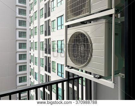 Air Compressor At Balcony Outside Condominium Area