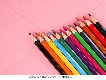 Colored Pencils On A Pink Background. Lots Of Different Colored Pencils. Colorful Pencil. Pencils Sh