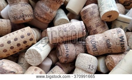 Odessa / Ukraine - 05 28 2020: Used Wine Cork Of Argentina Wine On Blurred Background Of Messy Wine