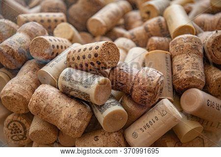 Odessa / Ukraine - 05 22 2020: Mess Stack Of Wine Corks Texture Closeup. Various Wine Bottle Corks F