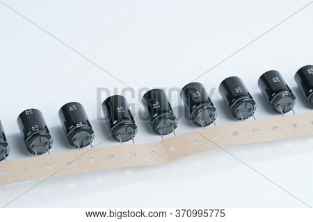 Electrolytic capacitors on a white background