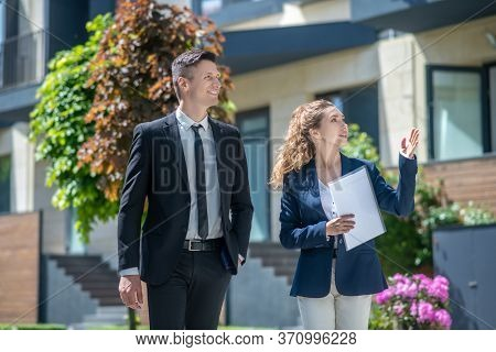 Female Broker Showing Houses With Apartments For Rent To The Client