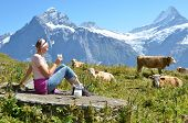 Girl with a jug of milk and a cow. Jungfrau region, Switzerland poster