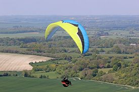 Paraglider Flying His Wing At Milk Hill