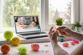 Selective Focus On The Hands Of A Man Sitting At The Table And Watching A Video Step By Step Guide O