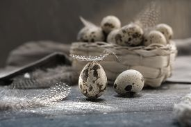 Quail Eggs In A Basket And On A Wooden Table. Rustic Farmers Organic Product. Local Farming Concept.