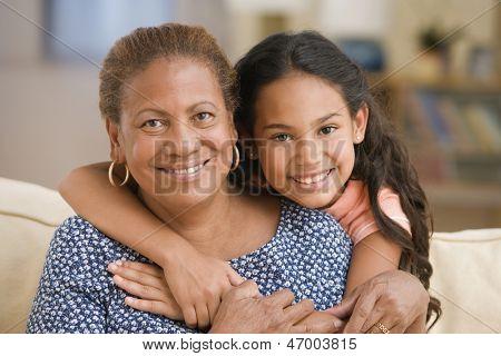 Grandmother and daughter hugging
