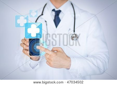 close up of male doctor holding smartphone with medical app