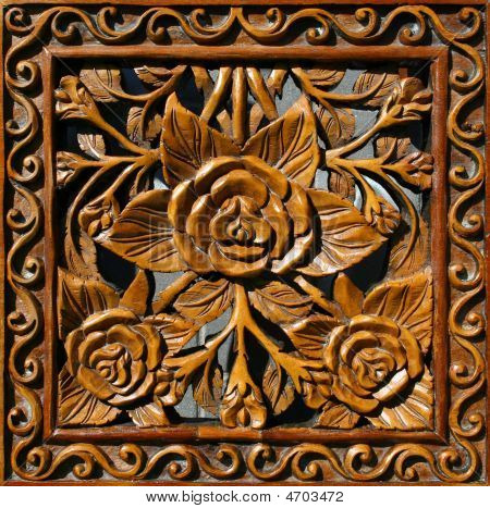 Wooden Panel With A Flower Ornament