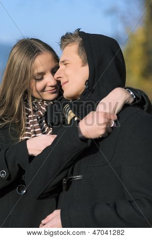 portrait of two beautiful caucasian people enjoying each other outside in park area poster