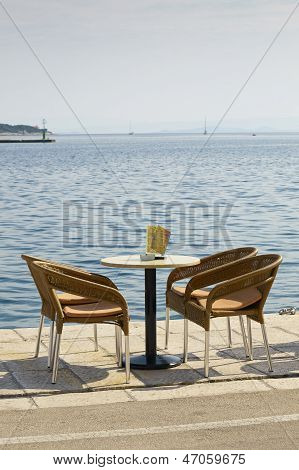 Empty Table And Four Chairs