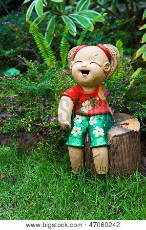 Ceramic Dolls In The Garden