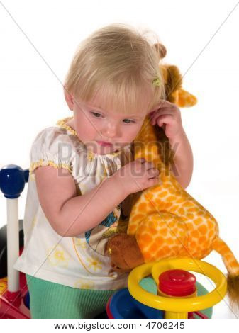 Child Sits Together With Toy
