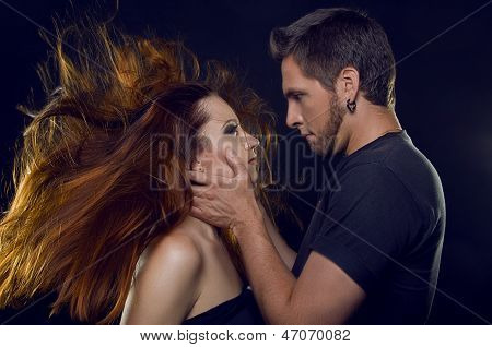 Couple Of Lovers. Cost Profile. The Guy Holding The Girl's Face And Her Hair Develop