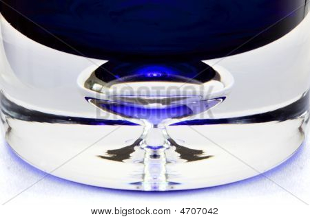 the bottom of a blue bottle isolated on a white background poster