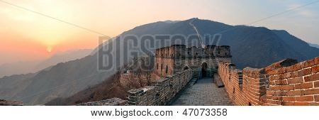 Great Wall sunset panorama over mountains in Beijing, China.