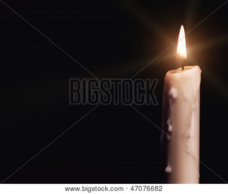 Burning Candle Over Black.