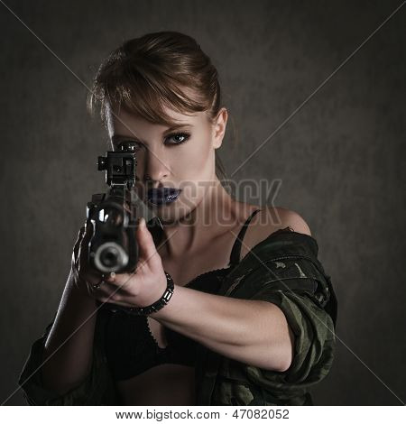 Beautiful Young Woman With A Rifle