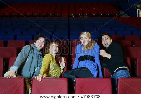 Four young scared friends see movie in cinema theater and move back in fear.