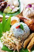 Nasi kerabu or nasi ulam, popular Malaysian Malay rice dish. Traditional east coast blue rice. Famous in states such as Terengganu or Kelantan . Malaysia food, Asian cuisine. poster