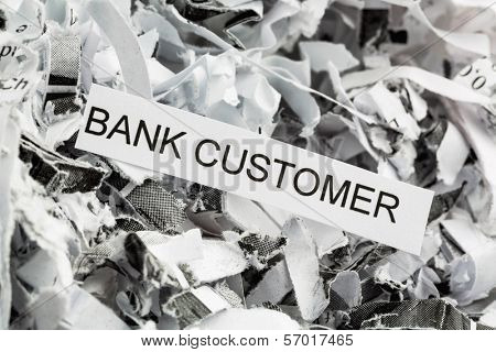 shredded paper tagged with bank customer, symbol photo for data destruction, customer data and banking secrecy