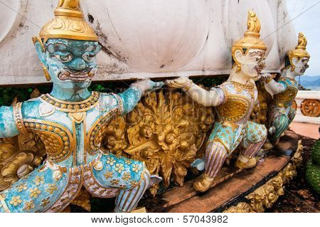 Warrior statues guarding a stupa at hilltop Tiger Cave Temple (Wat Tam Seua) in Krabi, southern Thailand poster