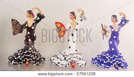 Three ornamental female flamenco dancers in
