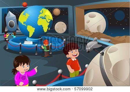Kids On A Field Trip To A Planetarium