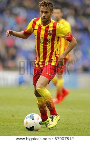 BARCELONA - MARCH, 29: Neymar da Silva of FC Barcelona in action during a Spanish League match against RCD Espanyol at the Estadi Cornella on March 29, 2014 in Barcelona, Spain