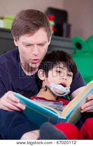 Father Reading Book To Disabled Little Son