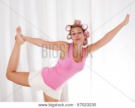Woman With Pink Curlers Is Dancing