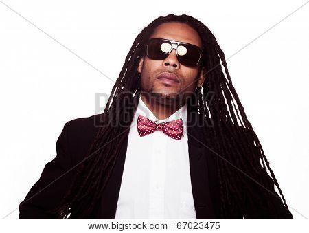businessman wearing sunglasses and suit dreadlocks