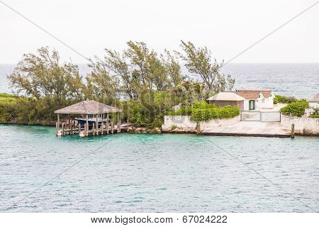 Boat Shelter And Home On Narrow Finger Of Land