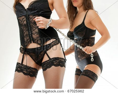 Two Women And A Chain