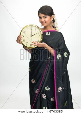 Asian woman holding big clock